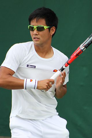 male tennis pro with sunglasses on
