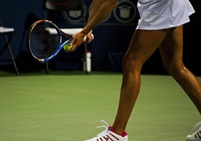 female tennis player serving